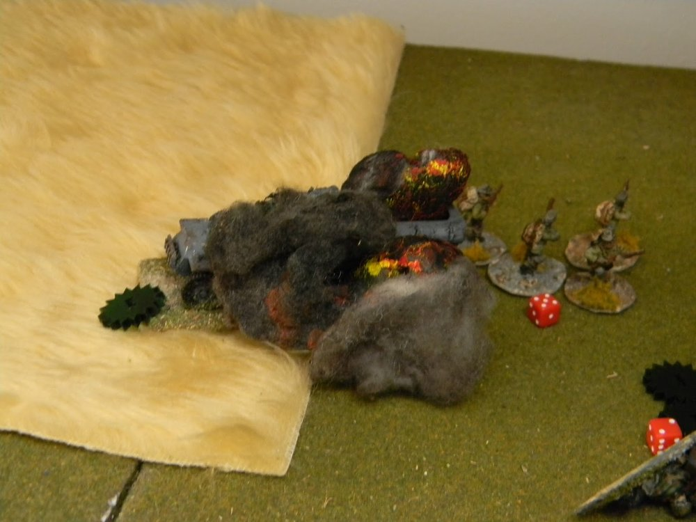 But line of sight is difficult with all these burning half-tracks in the way