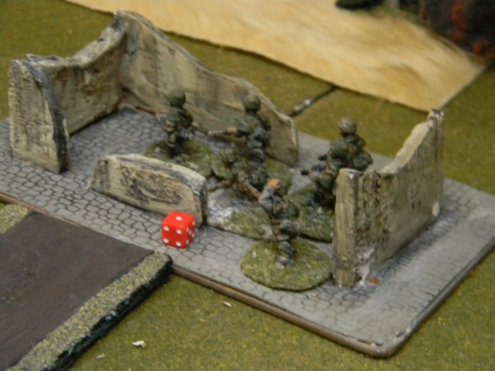 Some of the Panzer Grenadiers have made it into the ruins of the small churc