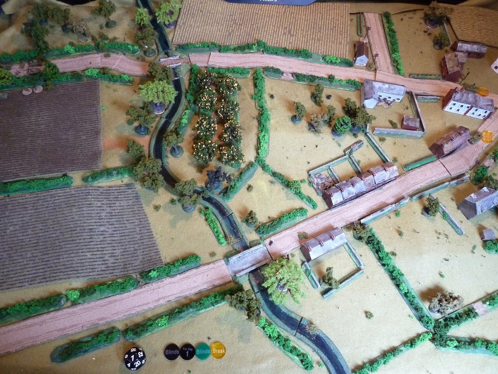 The Canadians enter top left, initially with a platoon of Shermans and infantry.   The plan is to advance a tank/infantry force up either side of the top road through the panted field and orchard to seize the crossroads.