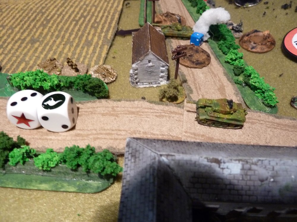 "The 1st section and PIAT gunner dash forward and take a shot at the Tiger:  and misses badly. An attempt to use 2"" mortars to blind the Panther scatters to behind the tank. The section are sitting ducks in the open!"