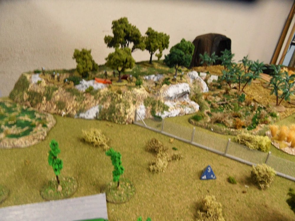 The FFL continued to engage the enemy from the hilltop, but made little progress.