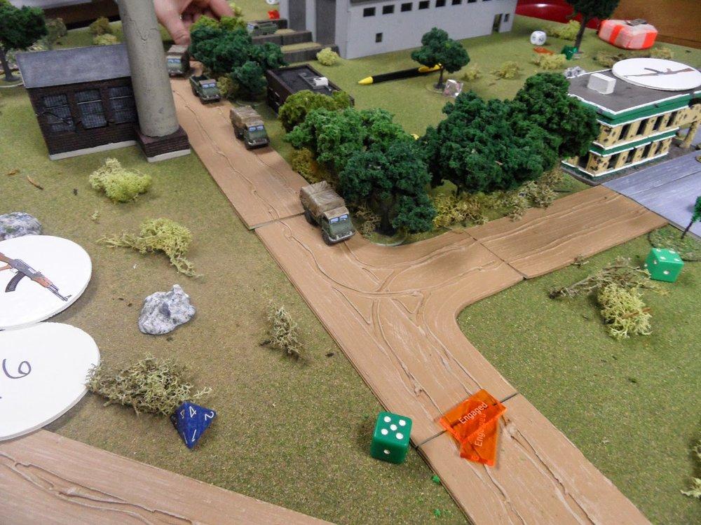 The convoy raced toward the gate.