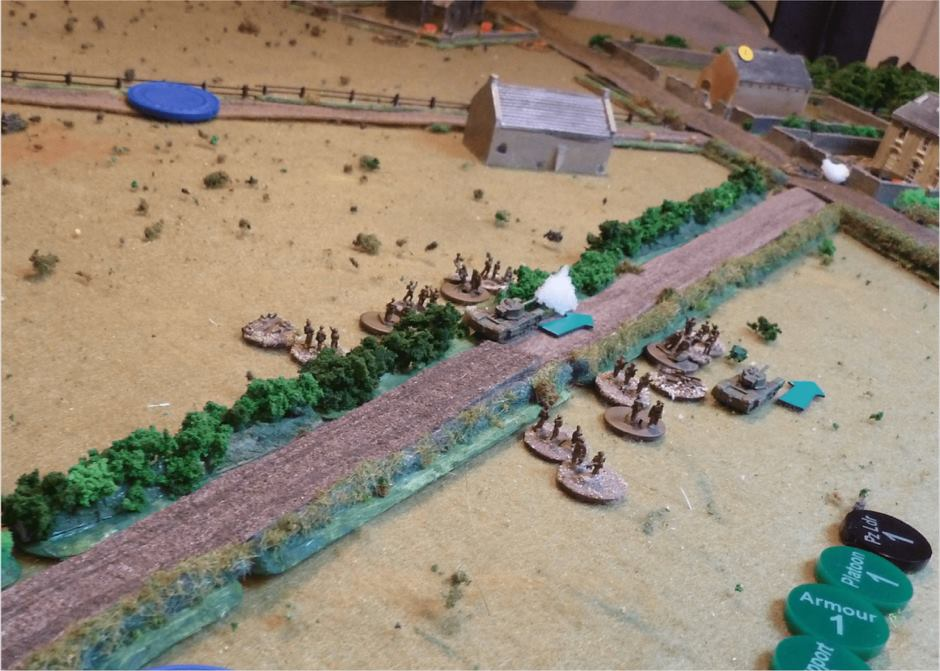 The German Panzer IV opens fire from the farm house front garden (see white smoke in the gateway) at the the Churchill, left out of shot on the road.    Meanwhile another Churchill has nipped through the field on the left of the hedge and in through a gate, and it too exchanges fire with the Panzer IV in the farmyard.    Luckily those Churchills are just tough enough to stand up to the 75L48, but their guns just can't seem to punch through the Panzer IVs armour: lots of hits on both sides, with the shock and damage starting to mount on the Panzer.