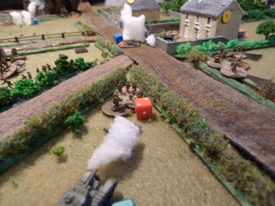 The epic tank duel continues, while two sections come out of the ditch and move down the alarmingly green hedge to flank the farm house.