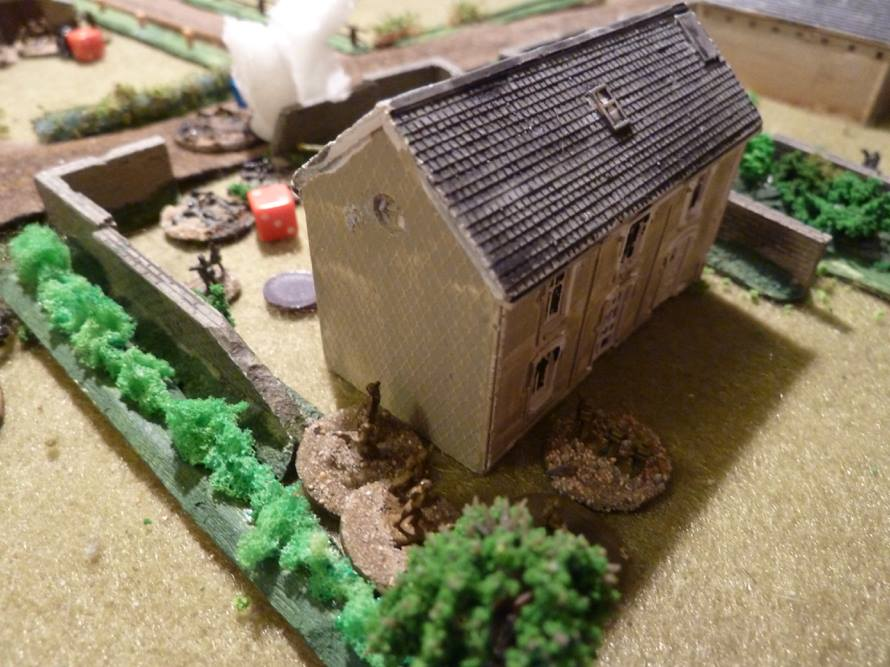The final assault: two squads from British #3 platoon storm into the rear of the farm house to take out the MMG upstairs and attack the German squad out in the front garden from close range.