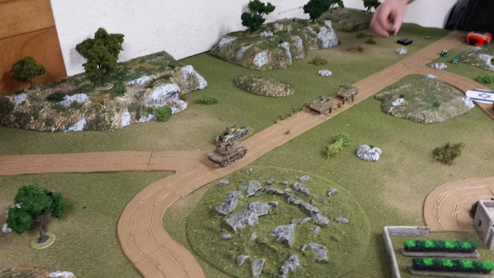 The Magach has its eyes on the prize, but the advance is slow as they round the walled orchard.