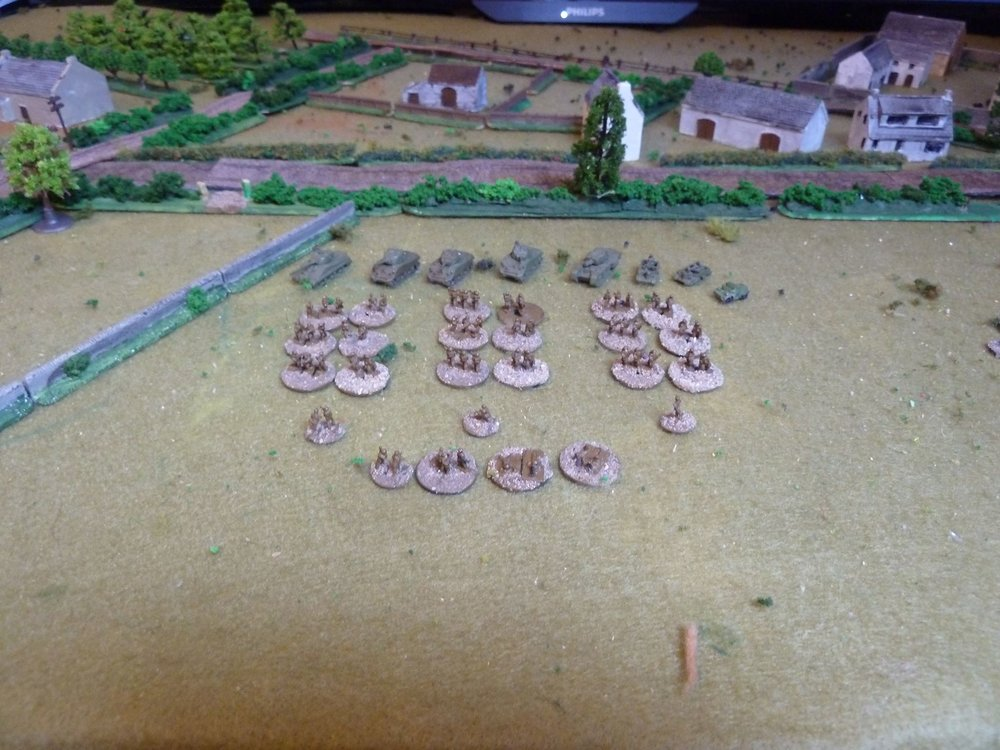 "The British Force • Company of Infantry:  3 Platoons, PIAT, 2"" Mortar + Co HQ (3), 2x(2) & 1x(1) leaders • Battery of 3"" mortars with observer in a scout car – 6 turns • 2 x 6"" square Pre-game stonk (which I forgot) • A Troop of Shermans: 3 x M4A3 with one M4A4 Firefly • One Churchill AVRE • Two Universal carriers with Vickers MMG"
