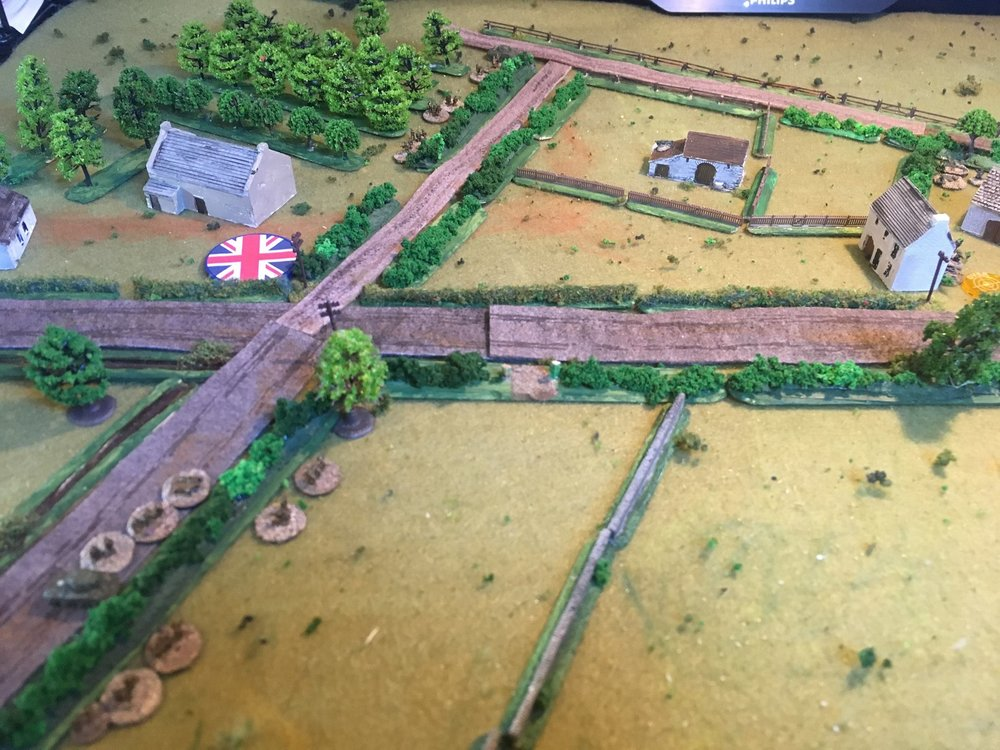 There is a German sniper hidden in the barn top centre. He spots the British No 1 platoon behind the hedge at the top.   No 3 platoon is also spotted from the house on the right holding a squad from No 2 Zug as it crosses the open field heading for the stone wall.
