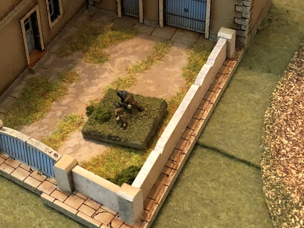 Below in the courtyard, the French 81mm mortar fires a spotting round at the German ATGs, which is off target...