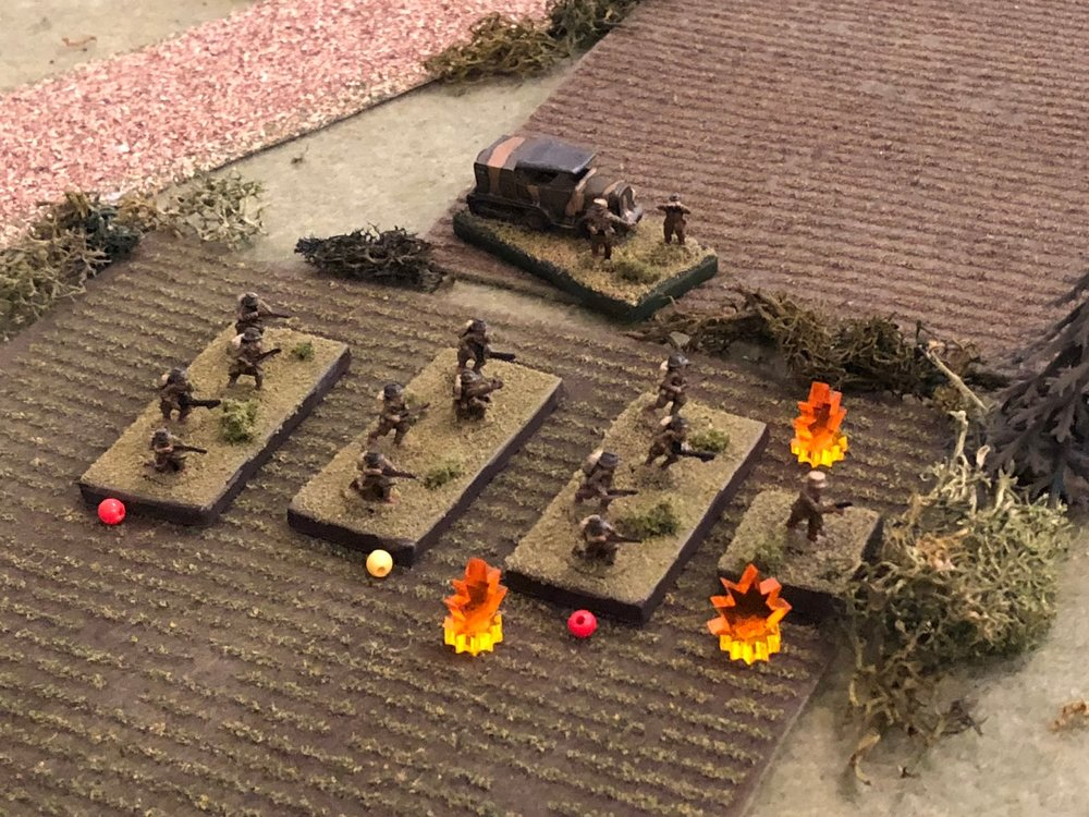 The German Motorcycle Platoon is unable to knock any of the French 1st Platoon's squads out, but the fire is pretty damn effective, suppressing two rifle squads and pinning the third.  Their Lieutenant and Capitan Cognac (top center) look on in exasperation.