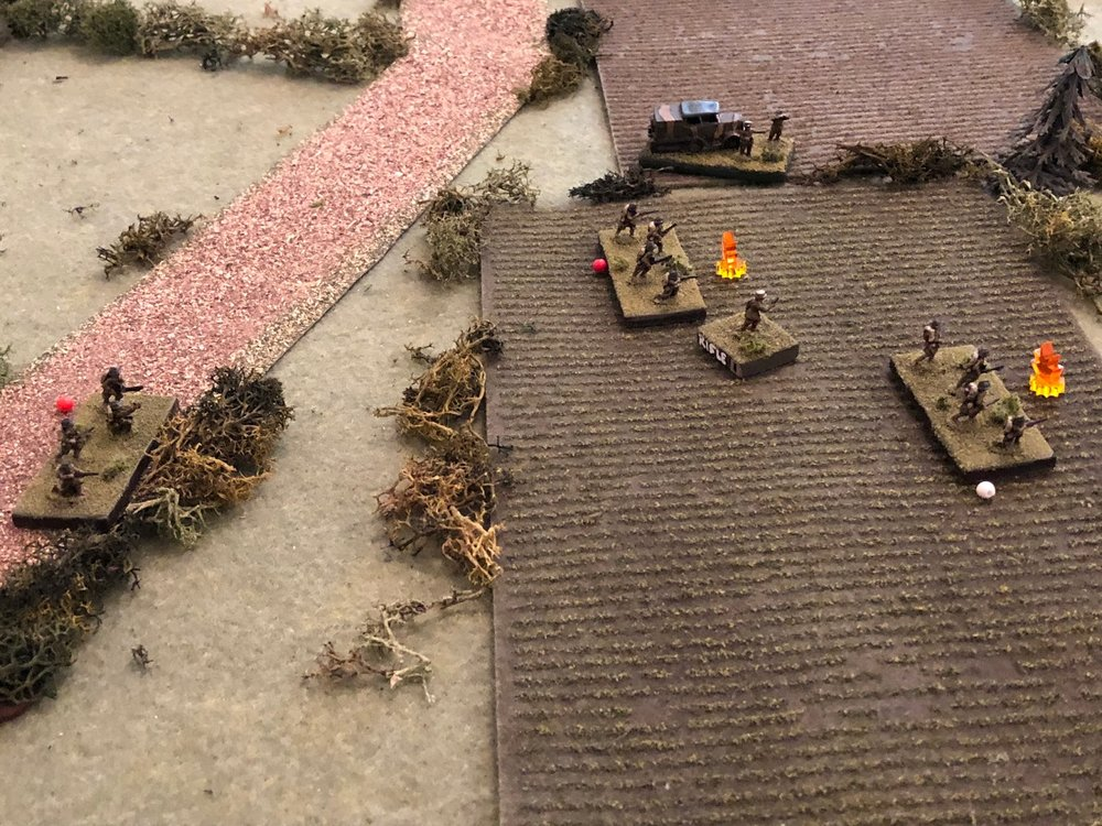 But the only success is in the south, where the French 1st Platoon is getting beat to hell.  They had a squad pinned that then failed it's rally and fell back, suppressed (far left), a squad suppressed (center top, with red bead), and a squad suppressed, with casualties (white bead at far right).  Their Lieutenant (center) and Capitan Cognac (top center) are unable to do anything due to the incoming German fire.     Very interesting.  Looks like the boy was correct in getting his company commander down there to help, as they sure need it, but even so, he hasn't been able to get anything done!  I can't believe I'm pretty much fighting the French to a standstill with just my infantry (the tanks just got here and haven't done anything useful yet).