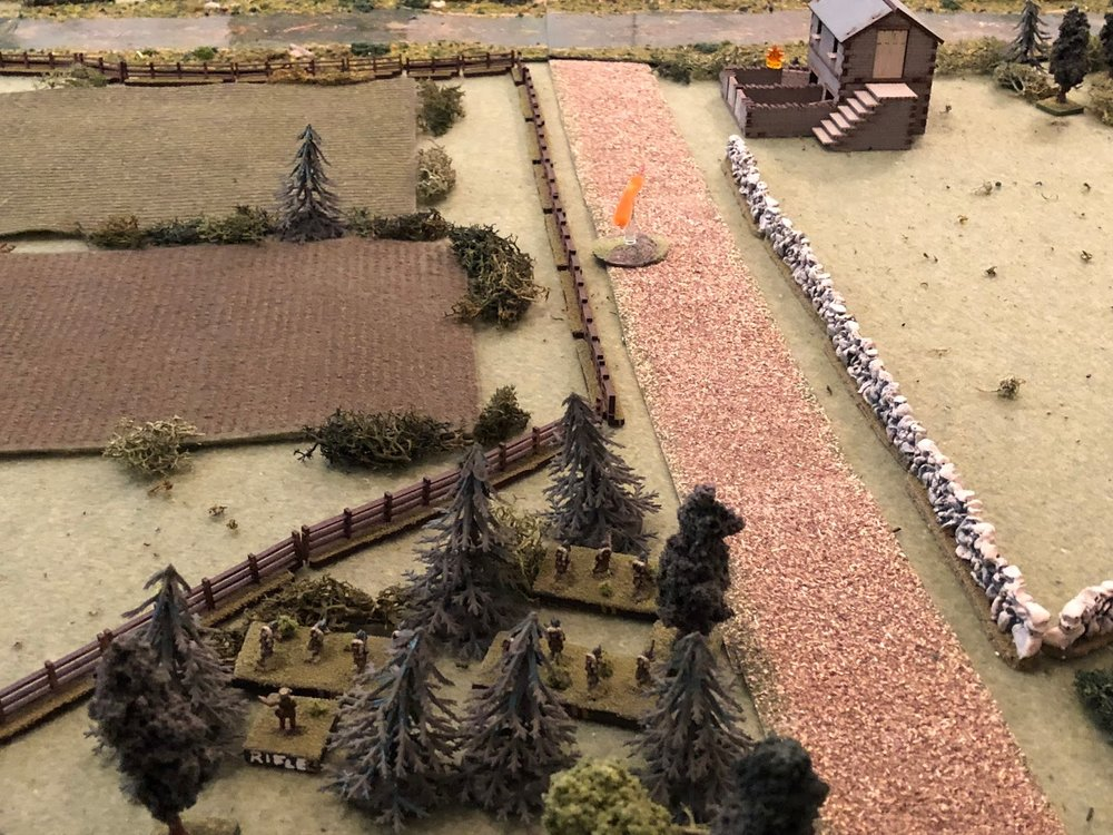 In the center, the French 2nd Platoon (bottom center) continues its advance, again firing on the German engineers at the tollkeeper's house (top right), but the Germans are no worse the wear for it.
