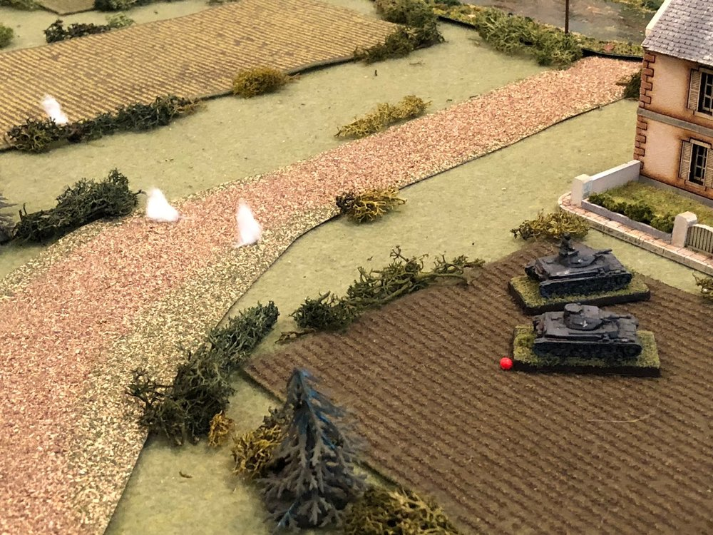 And it's enough to force Sgt Kapps to move his tank to shelter in the lee of the French house, right next to Sgt Graebner's vehicle, which had the exact same thing happen!