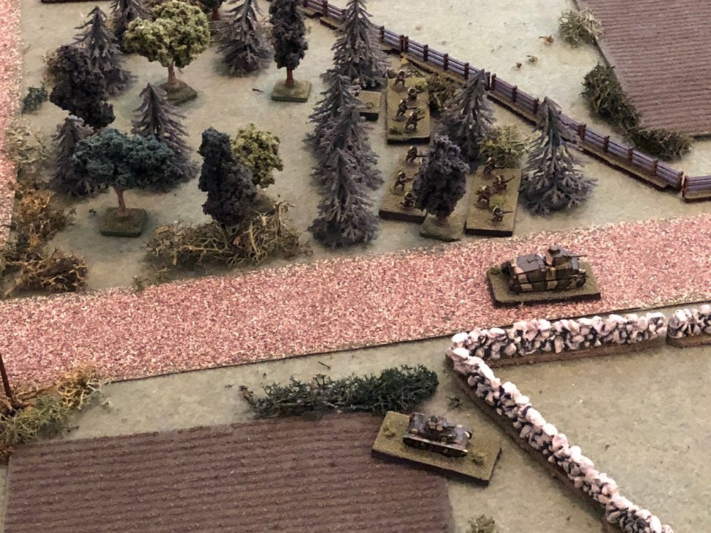 With both German tanks sheltering from the 75's fire, the southern Somua begins pushing east down main street (center right, with the H39 below it and 2nd Platoon above it, in the trees).  The boy is making his play, stuff is about to get interesting...