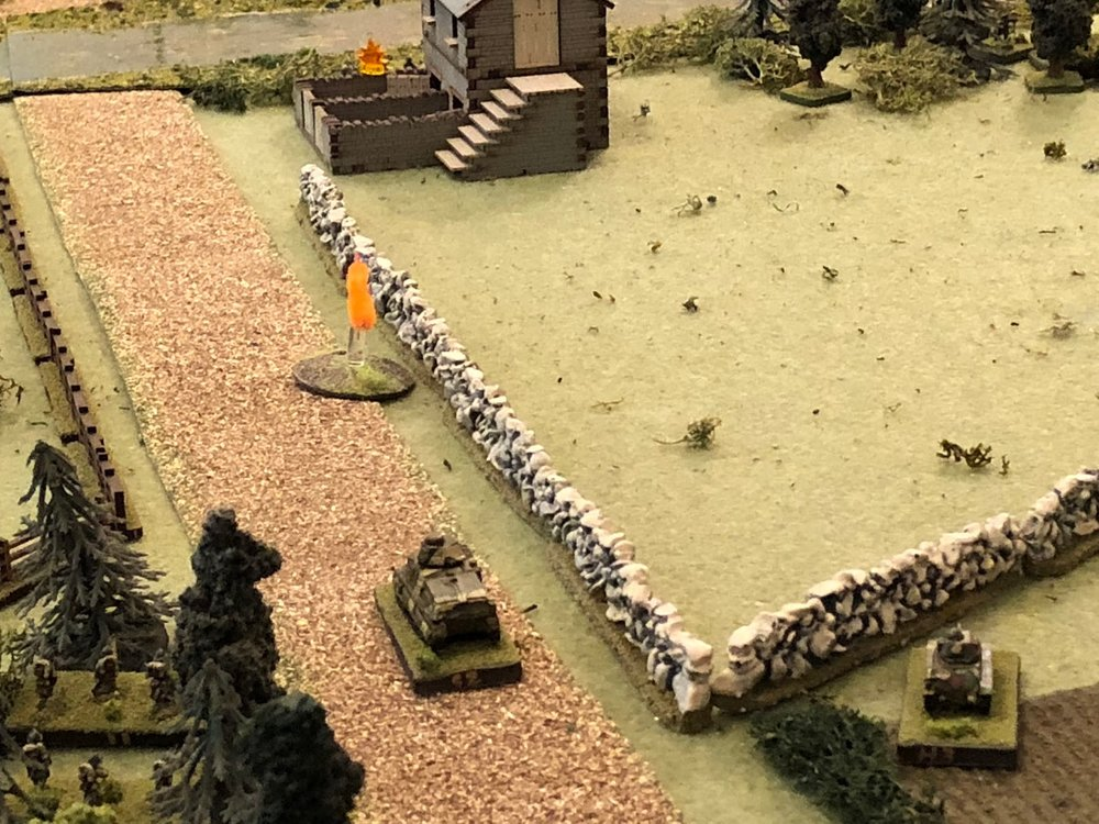 The Somua pulls up (bottom center) and fires on the tollkeeper's house...