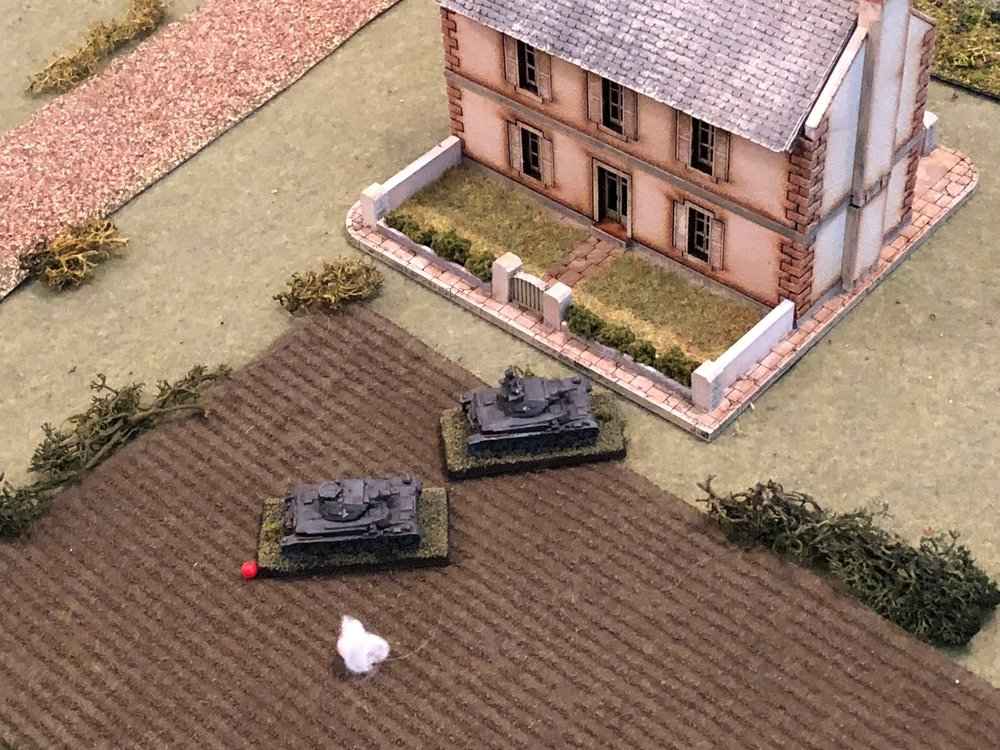 Sgt Graebner cautiously rolls his vehicle forward to see if he can acquirer a target, nosing past Sgt Kapps' tank, looking to spot the Frenchman firing on his partner.