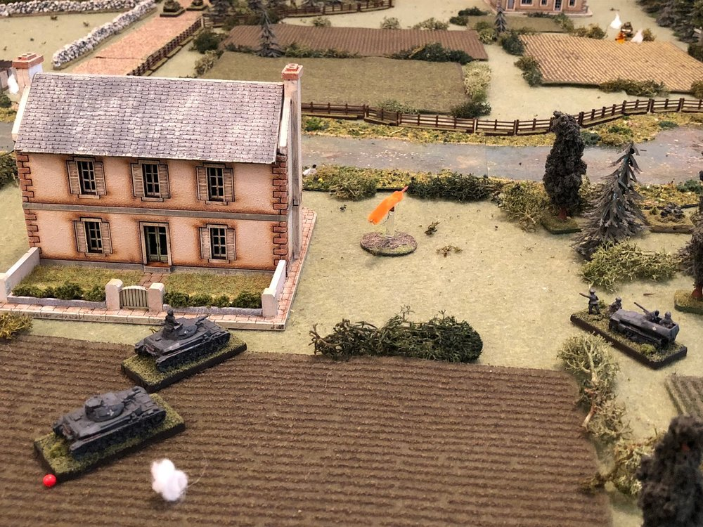 The German Commander, Lt Wehner (far right), looks on as Sgt Graebner's vehicle (left) trades shots with the northern Somua (top right), as Sgt Kapps (bottom left) tries to rally his shaken up crew...
