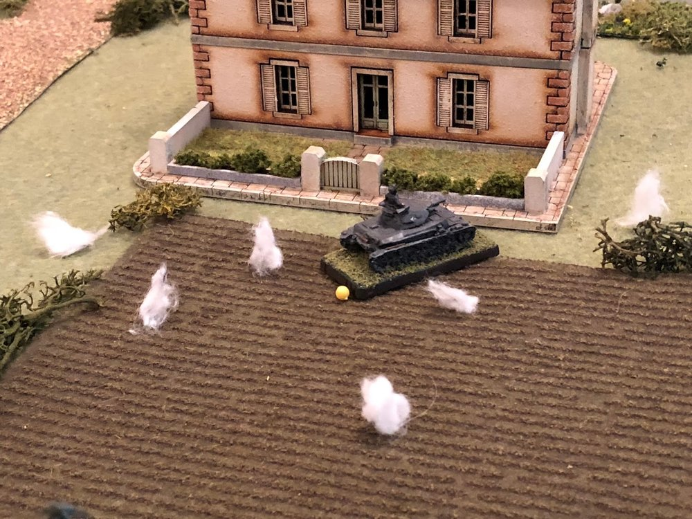 Sgt Graebner's Pz IV, pinning the crew behind Mlle Chevelle's house!  That is a significant development, the pin meaning Sgt Graebner can move his vehicle out to engage the French tanks on main street, but will more than likely not get the first shot off.
