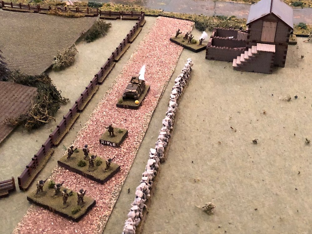 Back in the center on main street, the French Lieutenant for 2nd Platoon (center), orders his 1st Squad forward.  The French infantrymen double-time up the street (top center), slowing once they reach the tollkeeper's house (which has the German engineers on the other side).