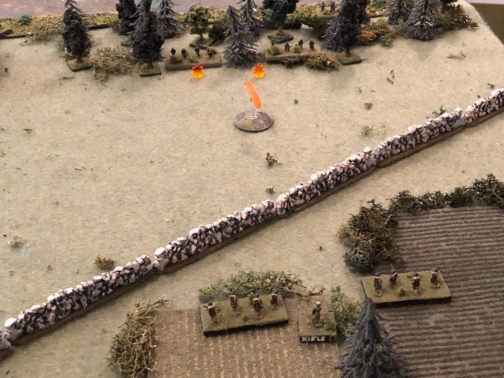 The French Lieutenant gets the remaining two squads of 1st Platoon on line (bottom, still haven't reached the wall!), where they open fire on the Motorcycle Platoon.