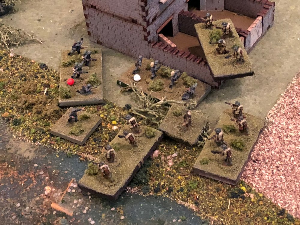The French 2nd PLatoon hurls itself around the tollkeeper's house and into close combat with the German engineers.  SSgt Gradl (left) leads the Germans, but Sgt Hafl's squad (white bead) and Sgt Barkstrom's squad (red bead) are both suppressed and not ready for the sudden French onslaught!   Rifles are fired at point blank range, then turned around and used as clubs; hand grenades are thrown, then picked up and tossed back.  Knives, bayonets, pistols, brass knuckles, entrenching tools, anything to give advantage, are brandished.  The NCOs and lone officer lead their men into the melee, screaming at the top of their lungs...