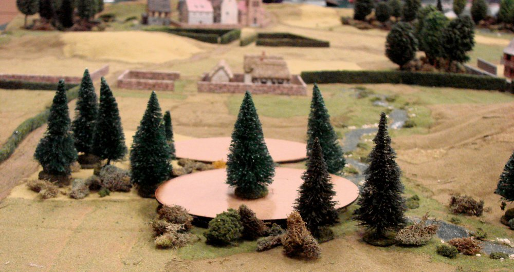 The Germans enter through the woods on blinds, one of the players cleverly disguising an approaching platoon by placing a tree on top of it. The Americans were not fooled.