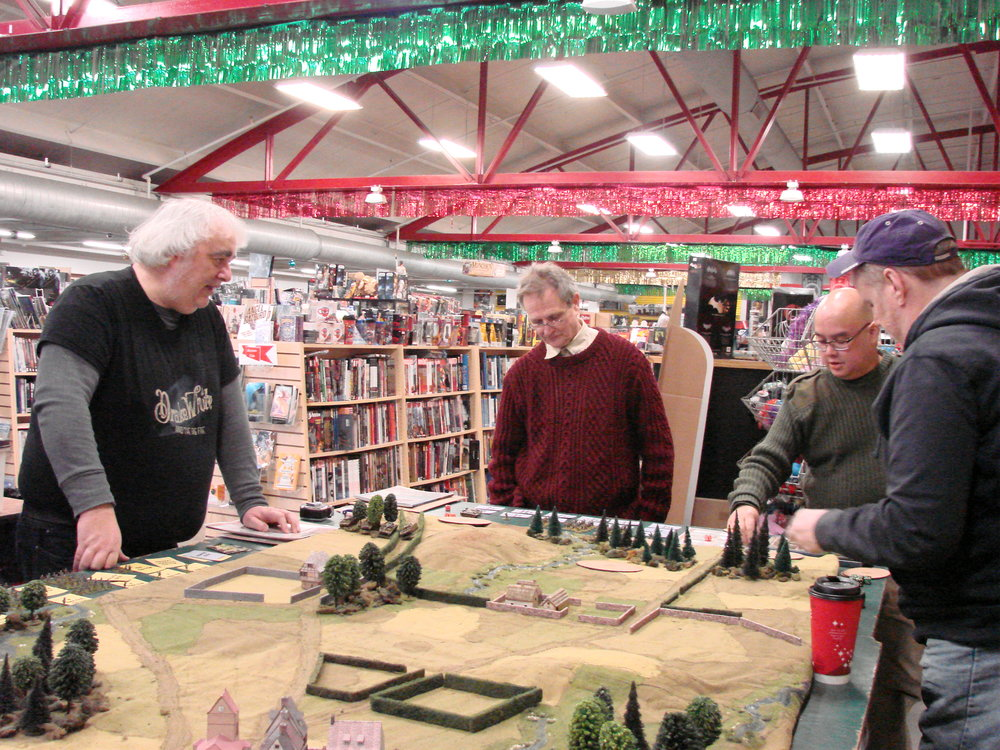 Mike Whitaker, guest gamemaster for the day, introduces the scenario to the German commanders.