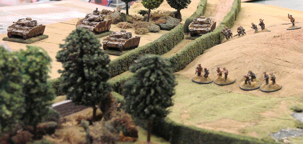 The advance on the chateau rolls forward while, unfortunately for the defenders, the battalion artillery is occupied with other targets.