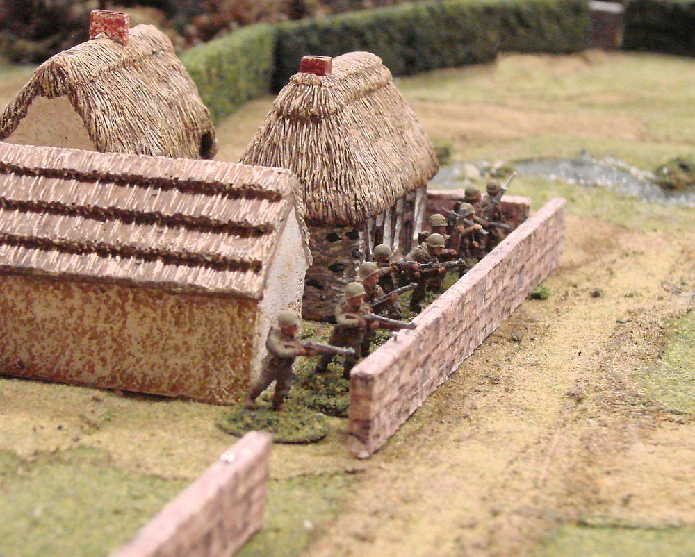 Third platoon takes up positions in the farm and the adjacent fields. First platoon remained with the company HQ, in reserve.