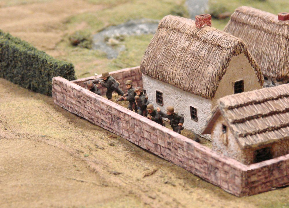 The Germans occupy the farm, only to be ripped by the fire of 50 caliber machine guns in the American second line.