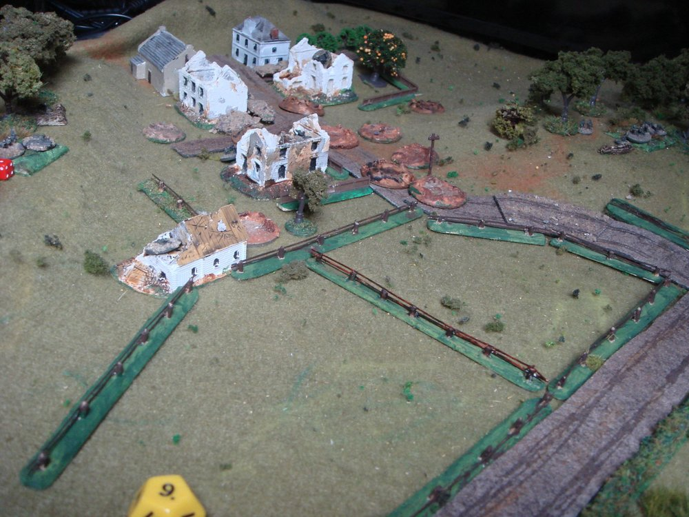 The is the view of the German held village with hills either side:a couple of squads each in left/middle/right.
