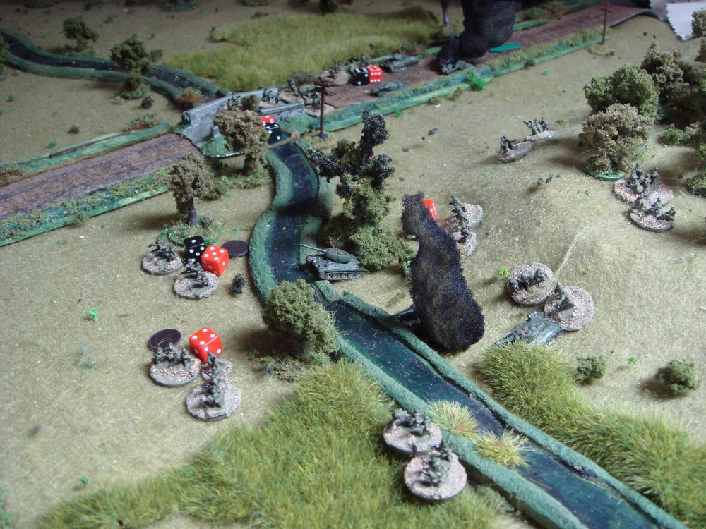 A close-up of the slaughter by the stream.  With half the Soviet force having taken heavy losses from the two MMGs, the Soviet company commander decides to call it a day. I'm sure the commissar will understand!