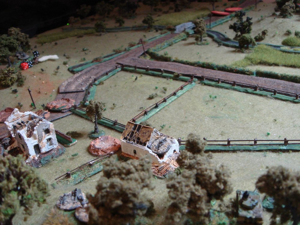 View from the South Western hill, with the Tiger and MMGs covering from the hills.  The Soviet lead platoon advances down the road with tank support under Blinds.