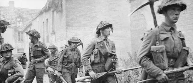 6th Royal Scots Fusiliers in action, 26th June 1944, during Operation Epsom, clearing the village of St Manvieu Norrey with the strain of battle obvious on their faces
