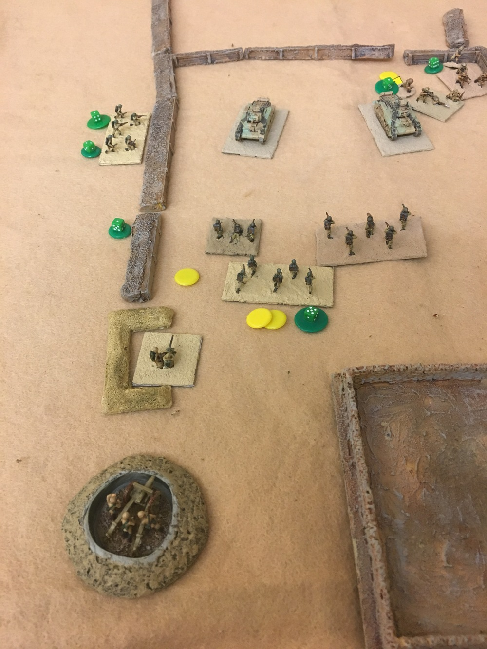 A lot has happened this turn with the Italians making their unsuccessful charge. The remain of three sections have been thrown back to a less than ideal position in front of the tanks.