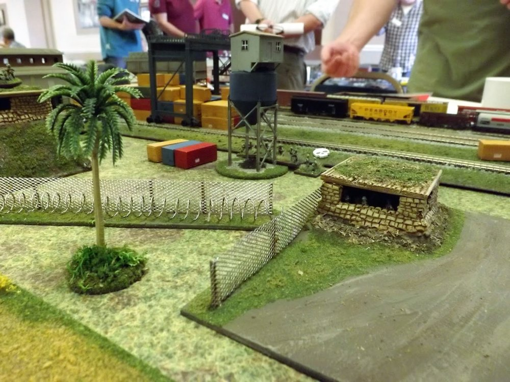US troops man positions on a quiet sector of the perimeter as the battle erupts to their right.