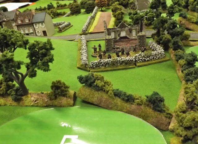 Zug 1, their attention focused on the road about to be close assaulted by British infantry manning the hedges to their right