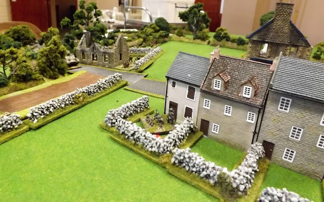 As the British move up to the outskirts of the village the one remaining MMG team open up on the unsuspecting Tommy infantry