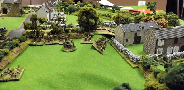 The British Company HQ sets up behind the lane just before first German spotting round lands in front of their position