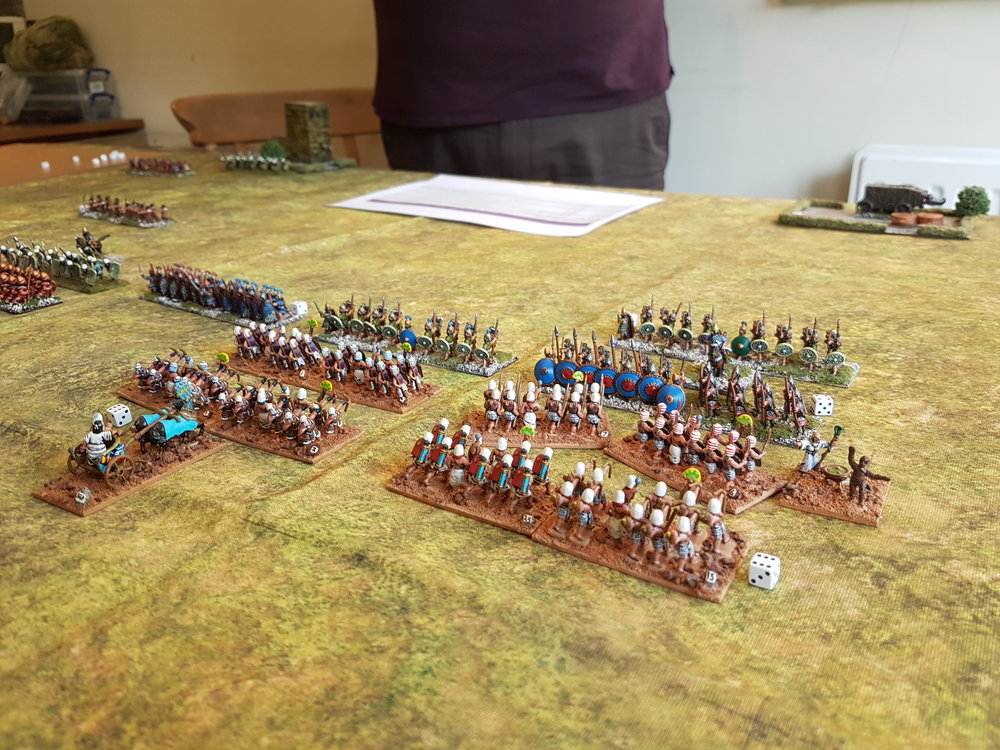 The axemen are out of shot, but are about to hit the Assyrian blue unit top right.
