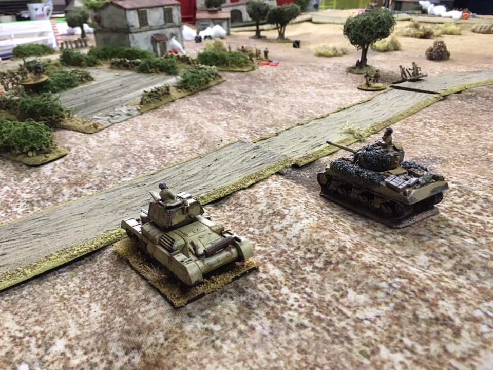 A British Sherman tank troop advances through the valley towards San Marco.   Observers will note the A10 being used as a temporary Sherman!
