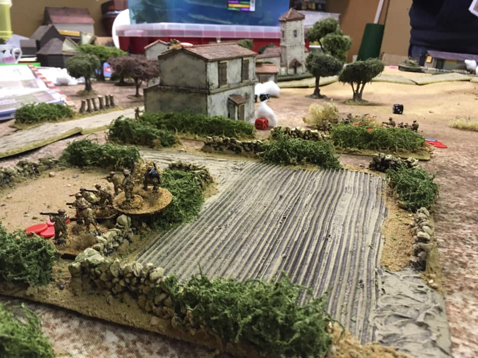 British infantry moving through the vineyards next to the Villa .