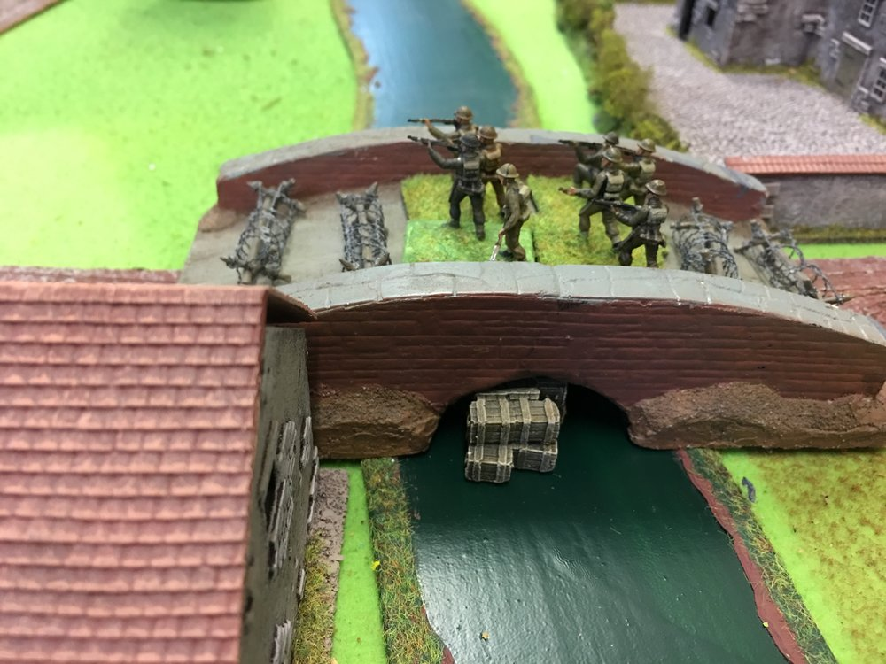 British pinned on the bridge, explosives are in position