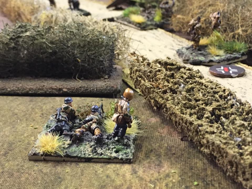 Fallschirmjager MG34 machine gun team covering the main road through the village.