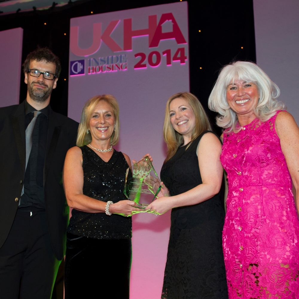 Collecting the UK Housing award, l-r: Marcus Brigstocke, HPBC trustee Linda Bright, Kate Reynolds, Sanctuary Group head of communication and engagement, and Tina Drury of category sponsors, Isos.