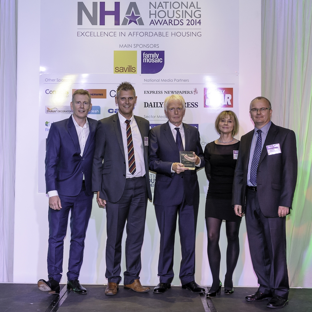 Pictured at the National Housing Awards, l-r, Patrick Kielty, Mark Birkin, of Sanctuary Group, HPBC trustee Jim Gill, Linda Storey of category sponsor Penningtons Manches, and Sanctuary's Andrew White.