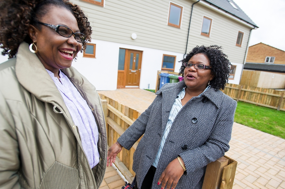HPBC home partners Florence Obiaju (left) and Joyce Msiska outside some of the recently completed homes.