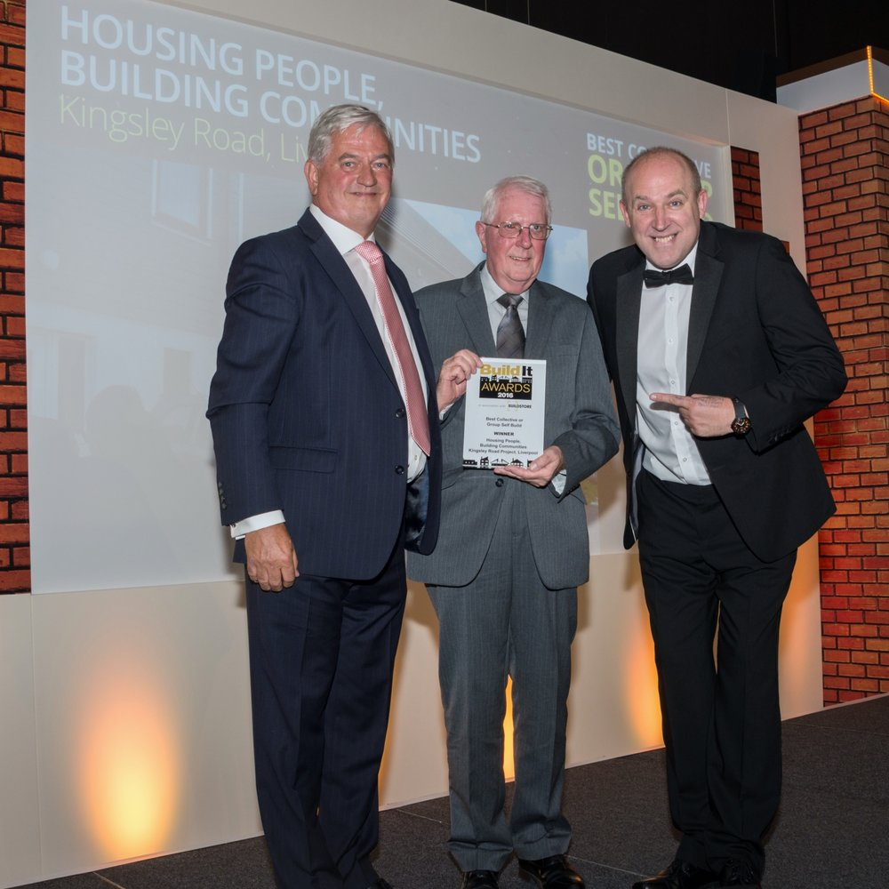 HPBC trustee     Brian Emmott (ctr), receiving the Build It award from host Tim Vine (right) and Paul Kempton of category sponsor Self Build Zone.