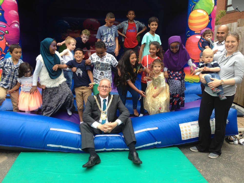 Lord Mayor of Liverpool Malcolm Kennedy tries out the bouncy castle with some of the Alt Street children