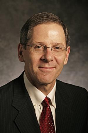 Peter Brews , Dean of the Moore School, University of South Carolina